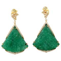 106.99 Carat Carved Emerald 18 Karat Gold Fish Tail Diamond Earrings