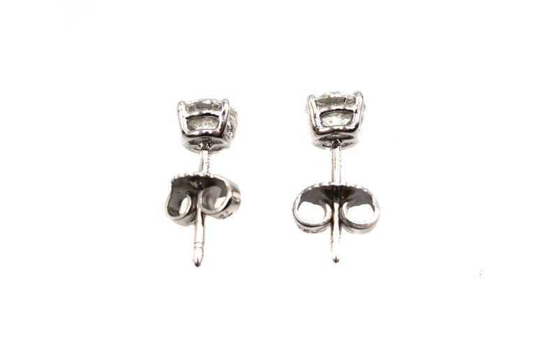 Round Cut 1.07 Carat GIA Certified Round Brilliant Cut Diamond Platinum Stud Earrings For Sale