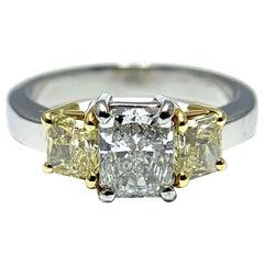1.07 Carat Radiant Diamond with Radiant Fancy Yellow Diamonds Set in Platinum