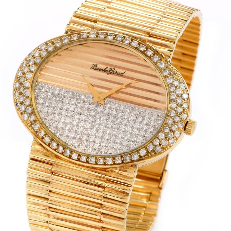 Dazzle and impress with this Vintage 1970s Bueche Girod Diamond 18K Gold Mechanical Watch!  This watch is crafted in textured 18 karat yellow and white gold and is purity marked.   Half of the 18k yellow gold dial and the surrounding horizontal oval
