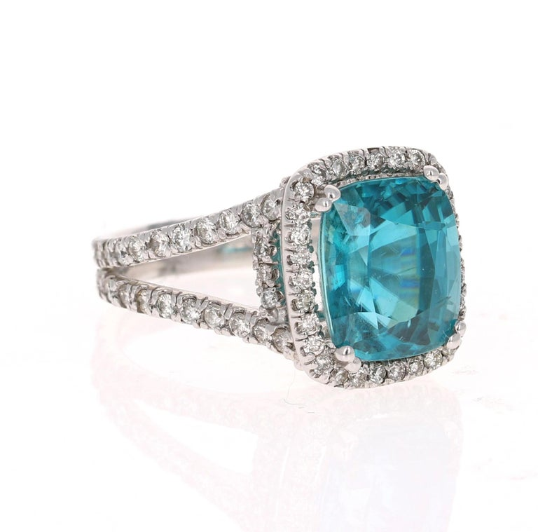 A beautiful Blue Zircon and Diamond ring that can be a nice Engagement ring or a gorgeous Cocktail Ring! Blue Zircon is a natural stone mined mainly in Sri Lanka, Myanmar, and Australia.    This ring has a large & beautiful Oval/Cushion Cut Blue