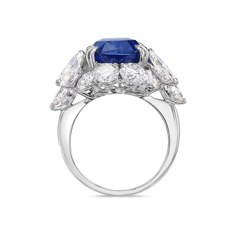 This cocktail ring features a 10.73 GRS certified vivid royal blue Madagascar heat modified octagonal radiant step cut sapphire, 8 round brilliant diamonds, and 6 Marquise diamonds set in 18K white gold. Size 6.  Resizeable upon request.  Viewings