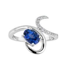 1.08 Carat Oval Tanzanite and 0.06 Carat White Diamond Ring