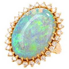 1080s Diamond and 18.60 Carat Opal 18 Karat Halo Cocktail Ring