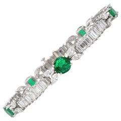 1980s Diamond Emerald Platinum Round Marquise and Baguette Bracelet