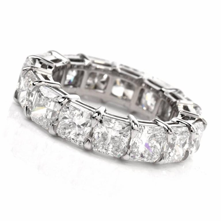 This Cushion diamond eternity Platinum band ring of outstanding sparkling aesthetic and timeless elegance is adorned with 15 high quality Cushion-cut diamonds, cumulatively weighing 10.90 carats, graded G-H color and VS1 clarity. The precious stones