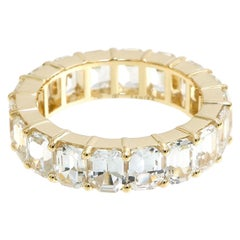 10.96 Carat Emerald Cut White Sapphire Eternity Band in 18 Karat Yellow Gold