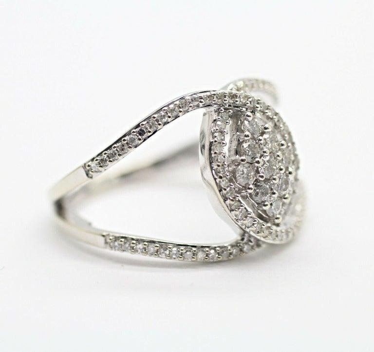 Contemporary 10 Karat White Gold Diamond Twist Ring For Sale