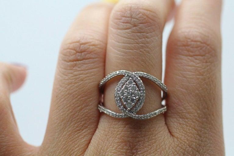 Round Cut 10 Karat White Gold Diamond Twist Ring For Sale