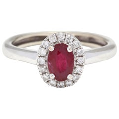 10 Karat White Gold Oval Ruby and Diamond Halo Ring