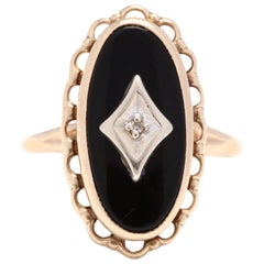10 Karat Yellow Gold Black Onyx and Diamond Oval Ring