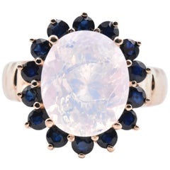 10 Karat Yellow Gold Opal and Sapphire Halo Ring