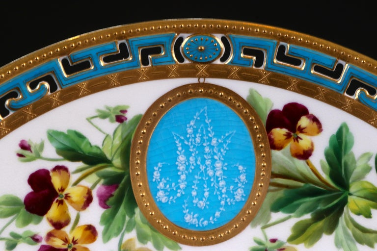 Here are 11 custom, monogrammed, hand painted pate-sur-pate cabinet or dinner plates from Minton, Stoke-on-Trent, England. The top of each plate is decorated with a unique spray of hand-painted flowers that surrounds a bleu celeste
