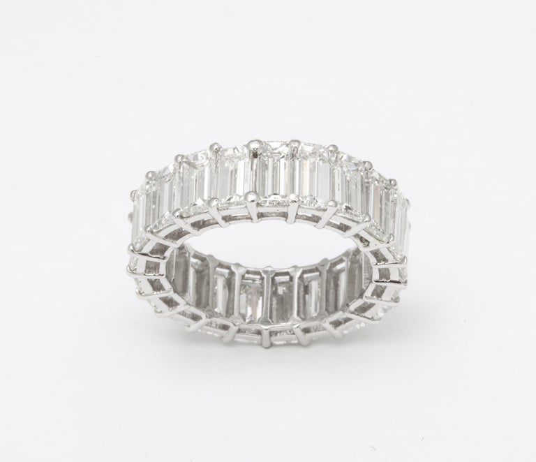 A FABULOUS emerald cut diamond eternity band!!  Over 11 carats of elongated emerald cuts set in platinum.  7.1 mm wide   *The emerald cuts have the length of approximately 1 carat each diamonds.*  Currently a size 7, but it can be adjusted if