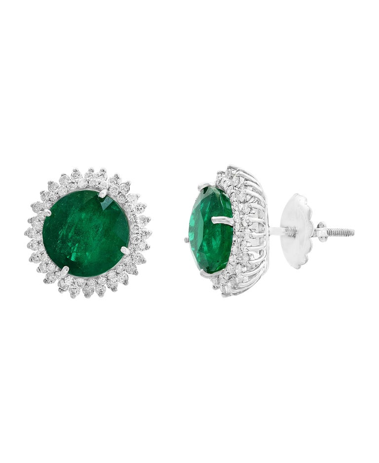 11  Carat finest Round Cut Emerald  perfect pair with  Diamond  Post  Earrings  14 Karat Gold  This exquisite pair of earrings are beautifully crafted with 14 karat White gold .  Fine  Round Cut Emeralds weighing approximately 11 carats  with no