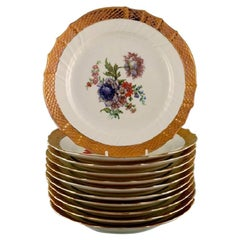 11 Royal Copenhagen Porcelain Plates with Floral Motifs and Gold Border