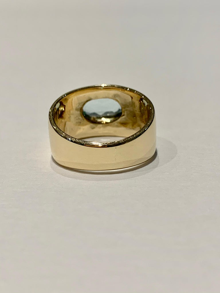Oval Cut Oval Aquamarine in Wide 9 Carat Yellow Gold Band For Sale