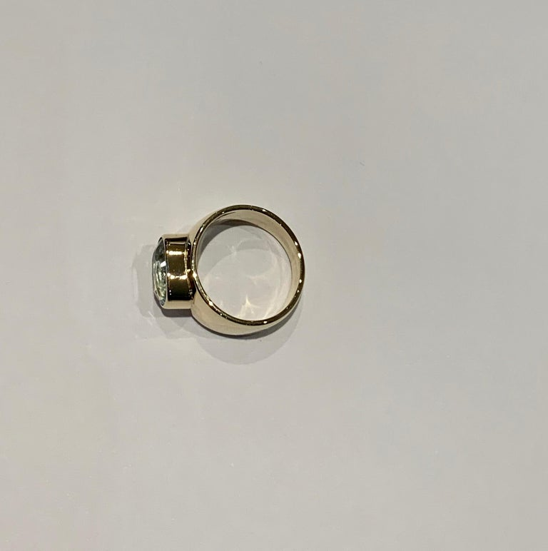 Oval Aquamarine in Wide 9 Carat Yellow Gold Band For Sale 1