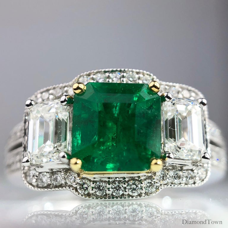 Women's 1.10 Carat Emerald and 1.03 Carat Diamond Ring in 18 Karat White Gold For Sale