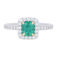 1.10 Carat Emerald and Diamond Ring, 14 Karat White Gold Halo