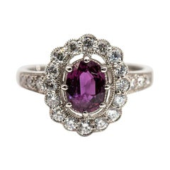 1.10 Carat Natural Oval Ruby and Round Diamond Platinum Halo Vintage Style Ring
