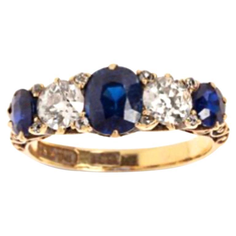 1.10 Carat Saphhires Diamonds 18 Carat Yellow Gold Jarretière Ring For Sale