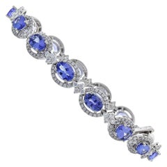 11.03 Carat Total Oval Tanzanite and Diamond Tennis Bracelet in 18 Karat Gold