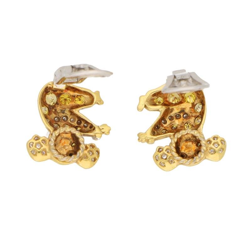 Modern 1.12 Carat Koala Bear Diamond, Fancy Intense Yellow Diamond, Onyx Clip Earrings For Sale