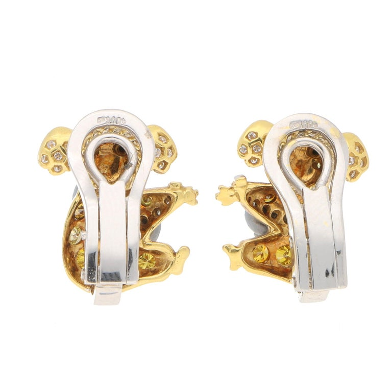 Round Cut 1.12 Carat Koala Bear Diamond, Fancy Intense Yellow Diamond, Onyx Clip Earrings For Sale