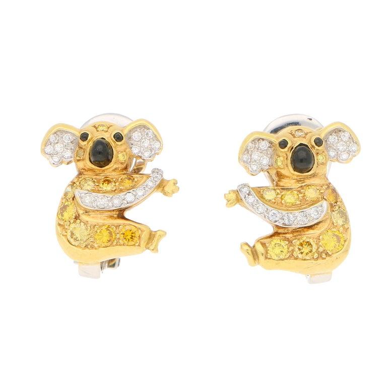 1.12 Carat Koala Bear Diamond, Fancy Intense Yellow Diamond, Onyx Clip Earrings For Sale