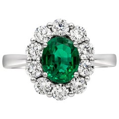 1.12 Carat Oval Cut Green Emerald and Diamond Halo Engagement Ring