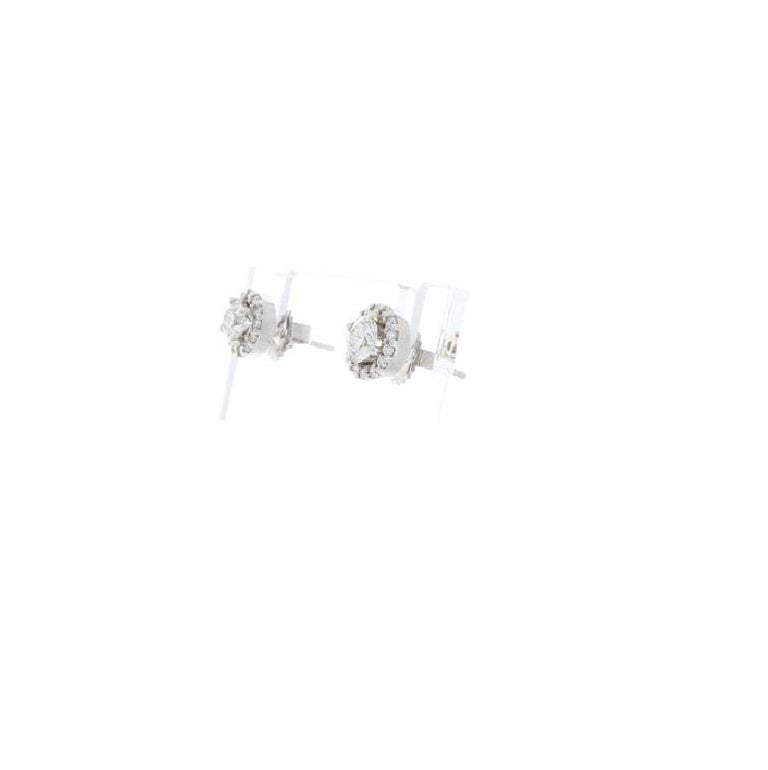 Diamond studs are always the perfect gift choice! It's a better gift if they are wrapped with more diamonds. They are versatile, comfortable, and most of all gorgeous. They exhibit the right amount of sparkle to amp up your look and add a touch of