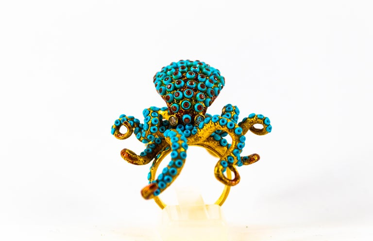 This Ring is made of 14K Yellow Gold. This Ring has 0.12 Carats of White Diamonds. This Ring has 1.00 Carats of Garnets. This Ring has also Turquoise and Enamel. Size ITA: 15 USA: 7 1/4 We're a workshop so every piece is handmade, customizable and