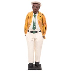 African Colonial Figure with Yellow Jacket