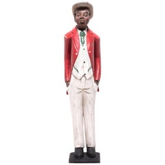 African Colonial Figure with Red Jacket