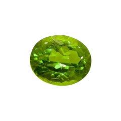 11.22 Carat Natural Unheated Oval-Cut Burmese Vivid Green Peridot