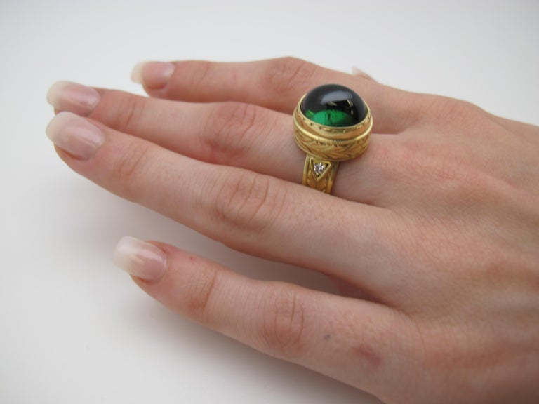 Artisan 11.28 ct. Green Tourmaline Cabochon, Diamond, Yellow Bezel Dome Band Ring For Sale