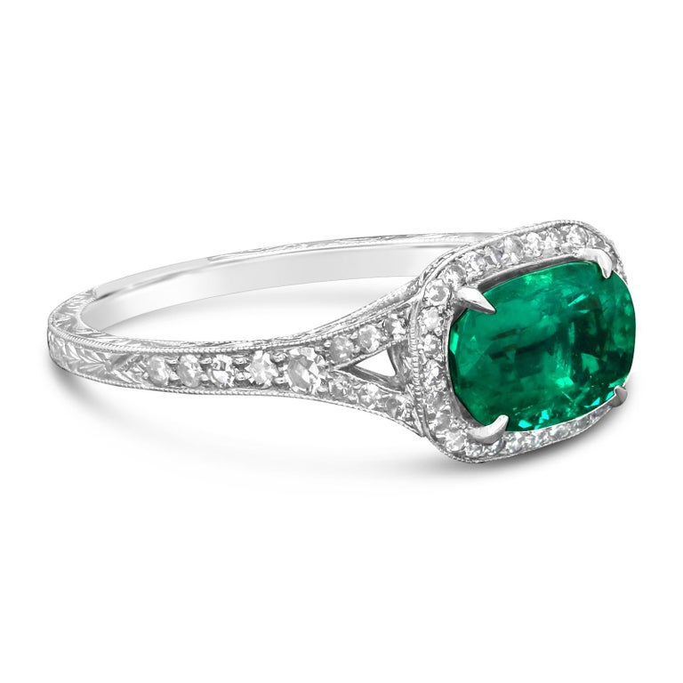1.13ct cushion cut Colombian emerald with moderate oil clarity enhancement with SSEF certificate. Further 0.35cts of single cut diamonds. Platinum with maker's signature and London assay marks UK size M, US size 6.5, can be adjusted to your own