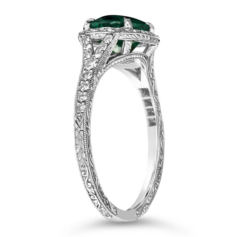 Contemporary 1.13 Carat Colombian Emerald and Platinum Diamond Cluster Ring by Hancocks For Sale
