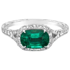 1.13 Carat Colombian Emerald and Platinum Diamond Cluster Ring by Hancocks