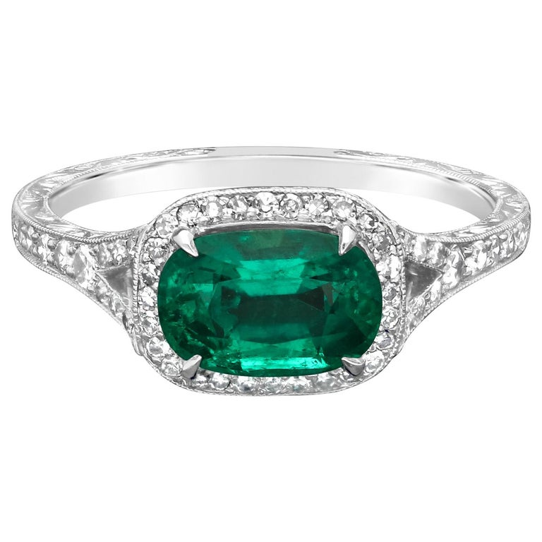 1.13 Carat Colombian Emerald and Platinum Diamond Cluster Ring by Hancocks For Sale