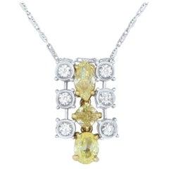 1.13 Carat Natural Fancy Yellow Diamond and 0.27 Carat White Diamond Pendant