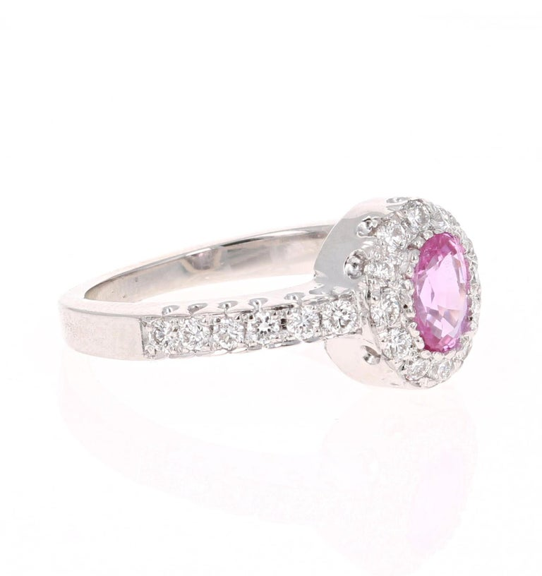Cute Pink Sapphire and Diamond Ring! Can be an everyday ring or a unique Engagement Ring!  This beautiful ring has a Oval Cut Pink Sapphire that weighs 0.69 Carats.   The ring is embellished with 24 Round Cut Diamonds that weigh 0.44 Carats with a