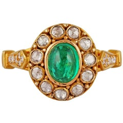 1.14 Carat Cabochon Emerald and Diamond Ring Studded in 18 Karat Yellow Gold