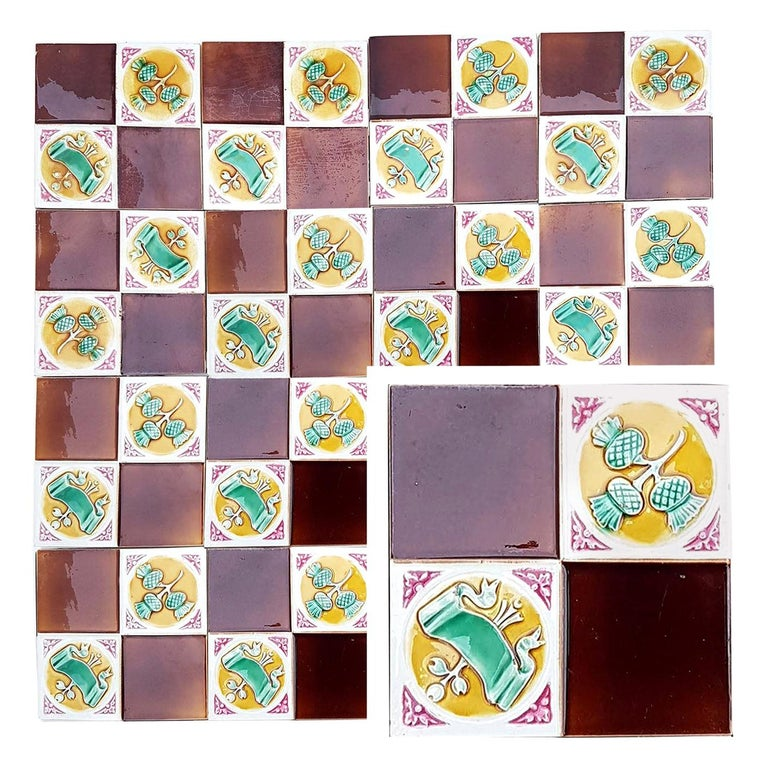 This is an amazing set of 115 original Art Deco handmade tiles by S.A. Faienceries de Bouffioulx, 1930s. A beautiful relief and color. With a stylish design. These tiles would be charming displayed on easels, framed or incorporated into a custom