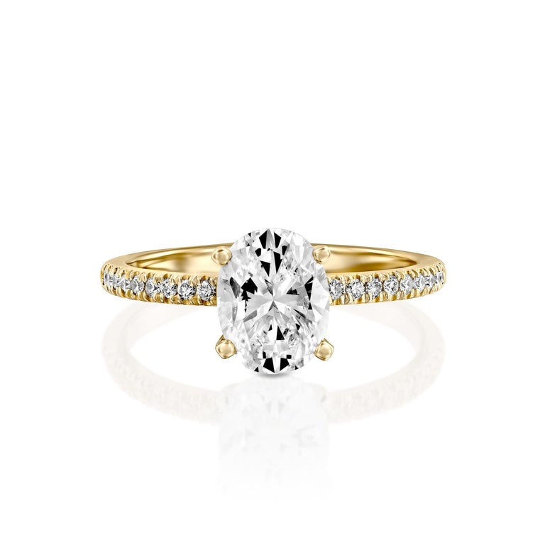 Exquisitely hand crafted ring features a solitaire GIA certified diamond. Ring features a 1 carat oval cut 100% eye clean natural diamond of F-G color and VS2-SI1 clarity and it is accented by diamonds of approx. 0.15 total carat weight. Set in a