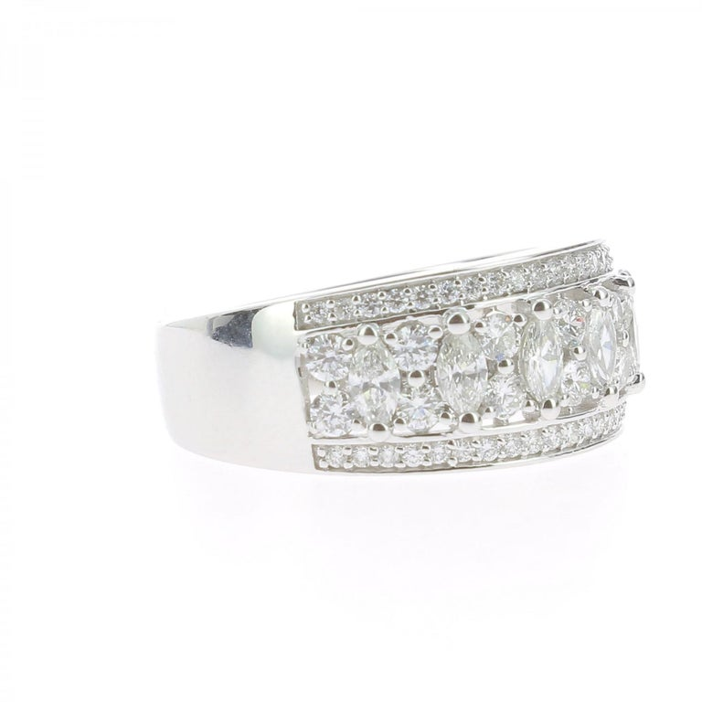 The Lace Ring is a unique and trendy ring set with 1,15 carat. The ring is paved with brilliants cut diamonds weighing 0.47 Carat and Marquise cut diamonds weighing 0.68 Carat. Craft in 18K White Gold weighing 6.24 Grams, the ring is set with GVS
