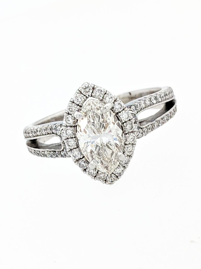 1.15ct Natural Marquise Cut Diamond w/Split Shank Halo Engagement Ring SI1/H-I  You are viewing a beautiful 1.15ct. natural marquise cut diamond set in a split shank halo engagement ring setting. The split shank halo setting is crafted from 14k