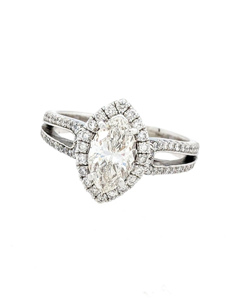 Contemporary 1.15 Carat Natural Marquise Cut Diamond with Split Shank Halo Ring SI1/H-I For Sale