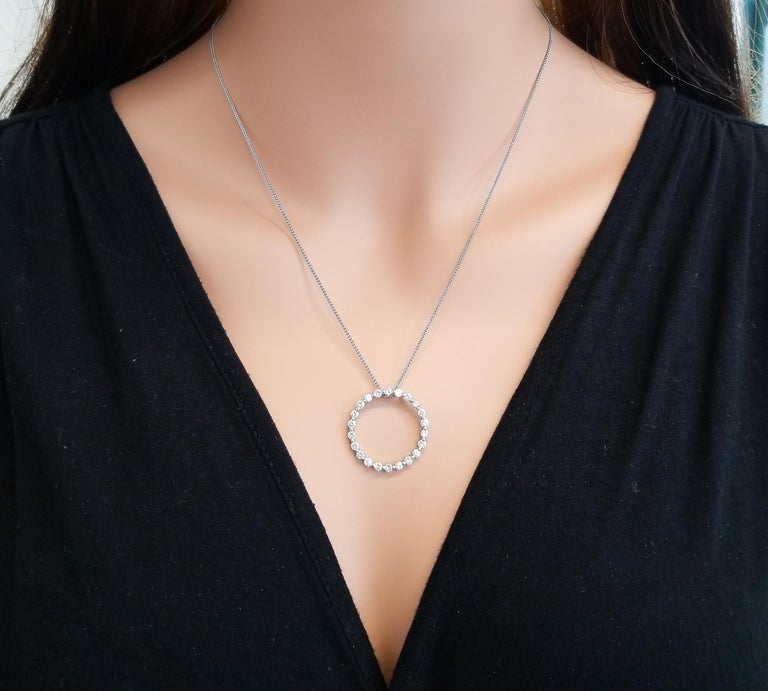This circle pendant is set ablaze with fiery round brilliant diamonds. This diamond classic is subtle yet sophisticated at the same time. Wear it with your favorite casual attire, or your dressiest dress. The pendant features 1.15 carat illuminating